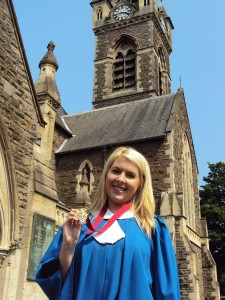 Rebecca with her Gold Award in front of St David's Church, Neath